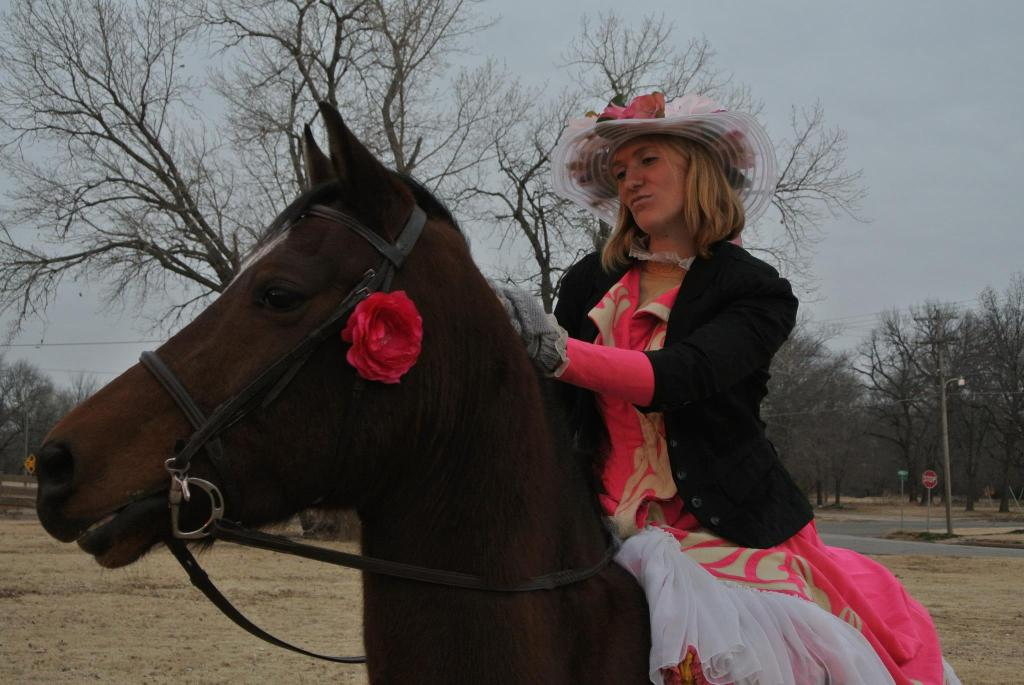 Krystal is riding on a rescued Morgan horse in a Victorian parade in Oklahoma