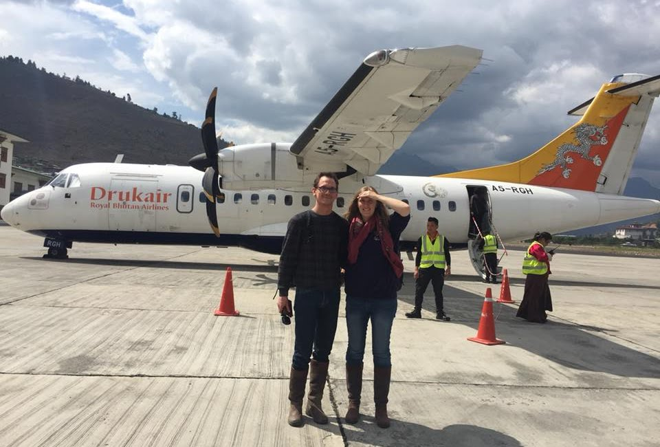 Boarding a propeller plane of Druk Air, the royal Bhutanese airline