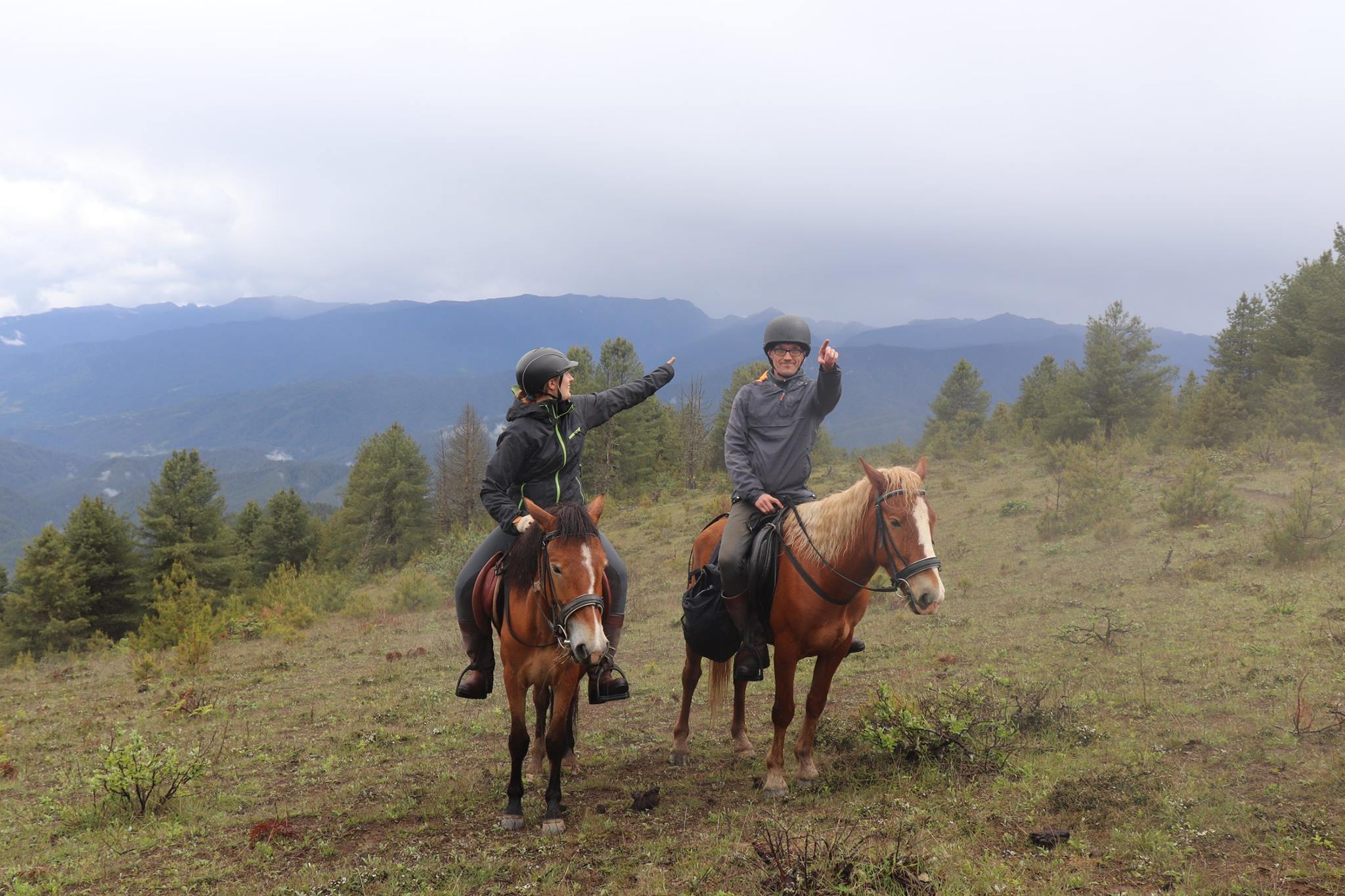 Two riders arguing about directions during horse riding in Bhutan