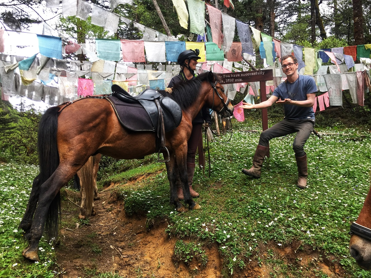 Krystal and her horse Firefly at the top of the Febila pass in Bhutan